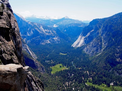 The edge of Half Dome is peeking around the rocks to the left of the image